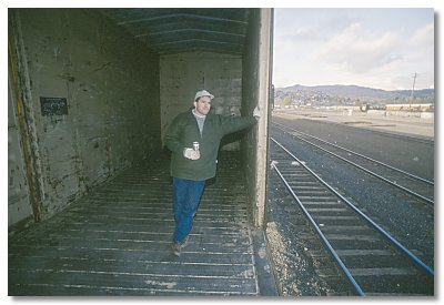 Gerry in boxcar in the Klamath yard