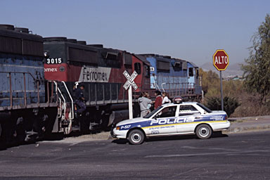 Waiting for police to investigate after the train hit a car in a crossing in Chihuahua