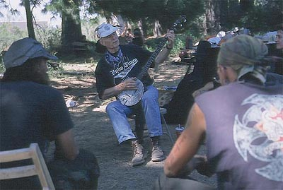 Banjo Fred performs at Black Butte camp
